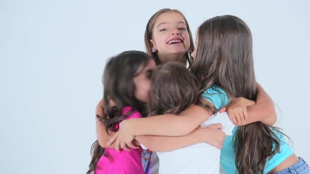 same : Little girls hugging and laaughing in the photo studio.
