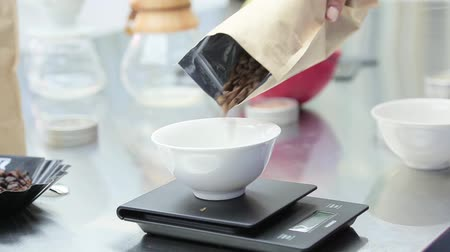 meal : Coffee beans are weighed on kitchen electronic scales. Stock Footage
