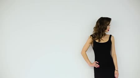 brown dress : Beautiful girl in black dress posing on a white background.
