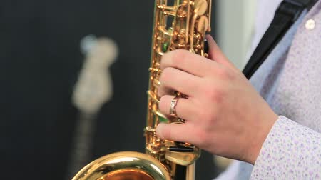 woodwind : A man playing the saxophone.