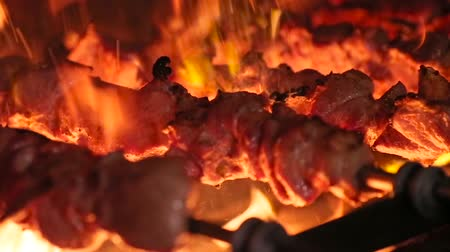 espetos : Meat on skewer roasting on the fire.