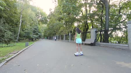 personal transporter : girl riding in the park on giroskutere. Stock Footage