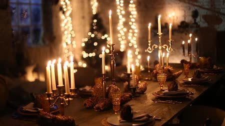 holidays : wooden table with burning candles.
