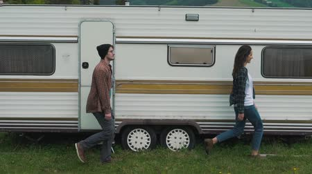 трейлер : Couple is walking near travel trailer. Стоковые видеозаписи