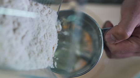 sifting : Man sifts flour close up. Stock Footage