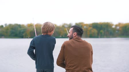 hoe : Father shows son how to fish.