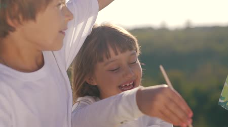 Cheerful children draw the picture. Stock Footage