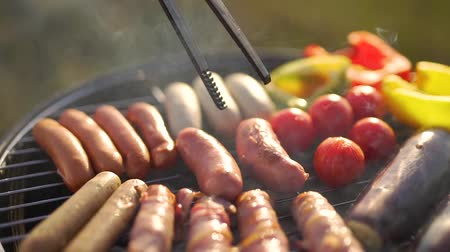 sausages and vegetables are grilled.