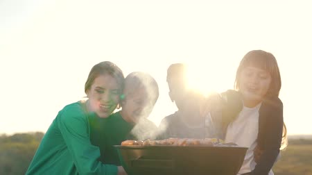 Happy family cook meat on grill. Stock Footage