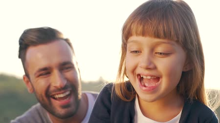 adore : Happy father hugs daughter on nature. Stock Footage