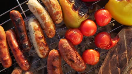 mustard : Delicious grilled sausages and vegetables.