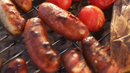 Delicious grilled dogs and vegetables. Stock Footage
