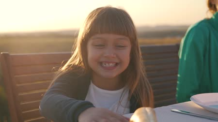 Little girl smiling at the table. Stock Footage