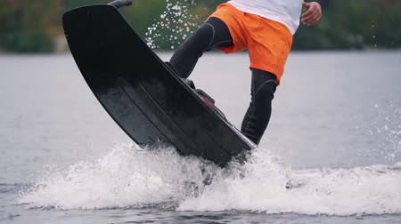 Man is riding on jet surf close-up.