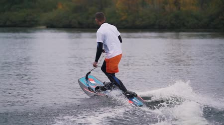Man is riding on jet surf.