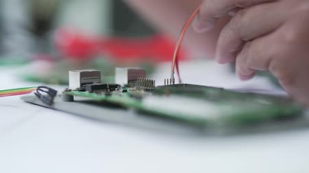 microelectronic : engineer solder a chipset close-up. Stock Footage