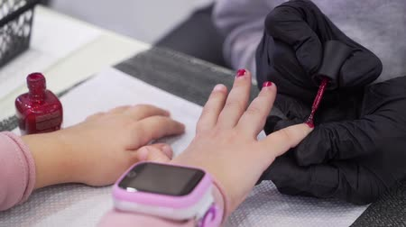 a girl with a smart clock makes a manicure.