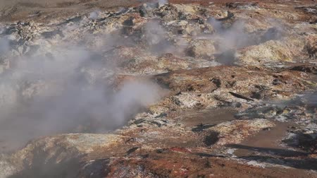 geyser iceland : smoke from the geysers in the valley. Stock Footage