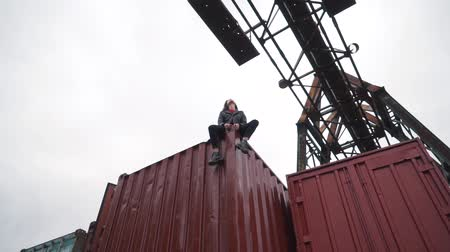 picture box : the girl sits on a freight container. Stock Footage