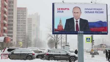 authoritarian state : Presidential election in Russia, 2018. Banner with president Putin in the street in St.Petersburg, Russia