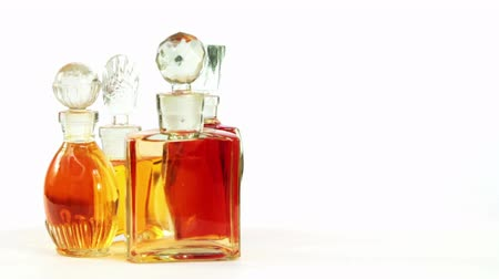 Several vintage glass bottles of perfume on a white background for your text