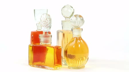 Bottles of the vintage parfume on white