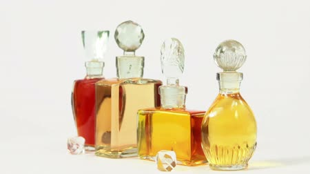 Vintage bottles of the parfume and the old glass beads on white Stok Video