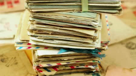 Pile of the old paper mail letters. Envelopes are stamped: Viewed by military censorship