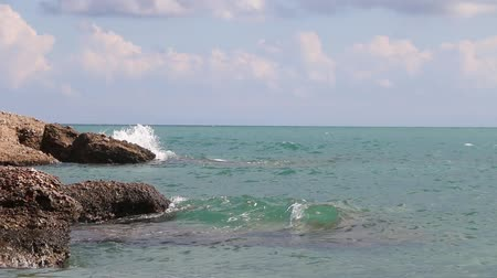 senhor : The waves hitting the rocky the shore in a sunny day. The sound of waves on the coast. Stock Footage