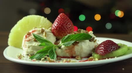 creams : Dessert decoration with strawberry, pineapple and walnut Stock Footage