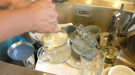 dishware : dirty dishes in the kitchen sink at home