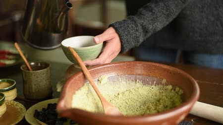 processo : people make the famous Pounded Tea, Hakka Traditional Beverage