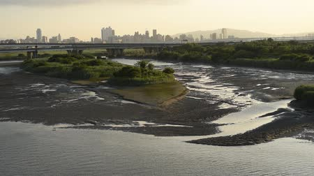 silhouette of buildings with river at sunset in Taipei