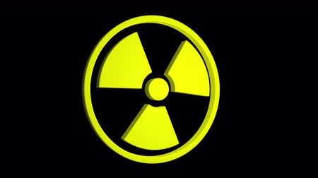 Radioactive yellow sign rotate isolated on black background Stok Video