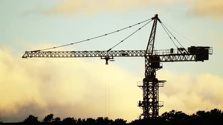 site : Construction site with tower crane at sunset