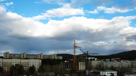 site : Cityscape with construction site and dramatic sky. Timelapse Stock Footage