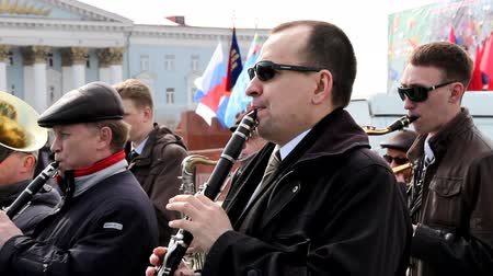clarinet : CHITA, RUSSIA - MAY 1: City brass band plays in the square during May Day political demonstration. May 1, 2012 Stock Footage