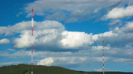 felhős : Timelapse of cityscape with television tower ans clouds