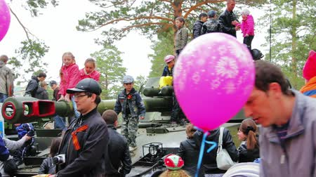 sivil : CHITA, RUSSIA - MAY 9: During a military parade in honor of Victory Day spectators can see panzers and take pictures. May 1, 2014