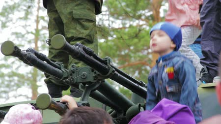 sivil : CHITA, RUSSIA - MAY 9: During a military parade in honor of Victory Day spectators can see panzers and take pictures. May 1, 2015 Stok Video