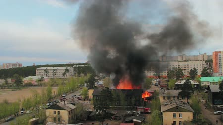 firemen : Wooden residential house in fire. Russia