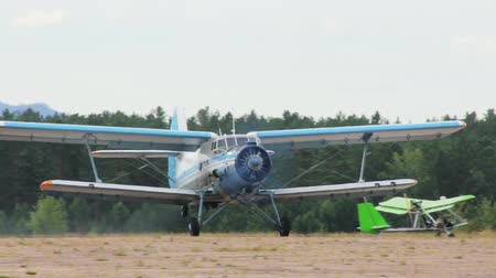CHITA, RUSSIA - JULY 18: Russian Antonov An-2 retro biplane take off. July 18, 2012