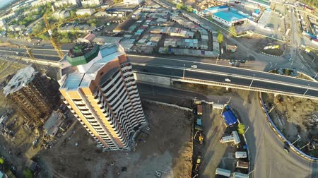 záběry : Construction site with crane  and highway shot from UAV quadcopter