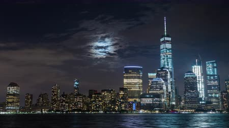 flatiron building : Lower Manhattan and Freedom Tower and Moon New York City Night Timelapse
