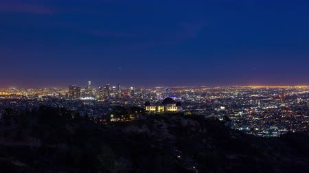 us bank tower : Downtown Los Angeles and Griffith Observatory at Dusk Night Timelapse Stock Footage