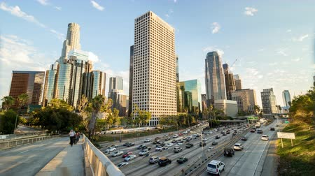 us bank tower : Downtown Los Angeles Golden Hour and Rush Hour Traffic Day Timelapse Stock Footage
