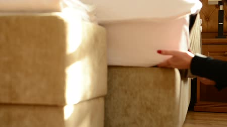 reception : housemaid covers a bed. Dolly shot Stock Footage