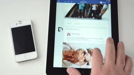 rede social : Facebook on an iPad display