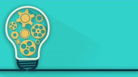 коммерция : idea concept. Animated rotation gears into light bulb on blue background. 4K video.