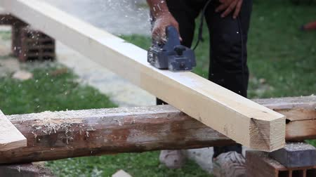 yerleşim : Preparing a roof beam for the construction project... Stok Video